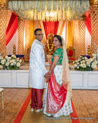 Indian Bride and Groom Holding hands to each other