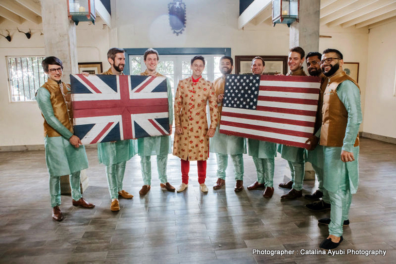 Indian Groomsman showing America and United Kingdom flag