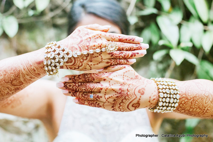 Indian Bride showing her Mahendi Design