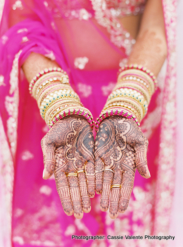Indian Bride showing her Mahendi Design