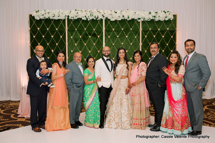 Indian Couple Posing with bridesmaids and groomsmen