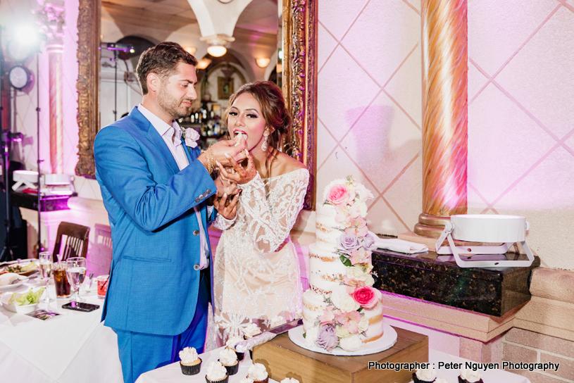 Indian Groom feeding cake to Indian Bride
