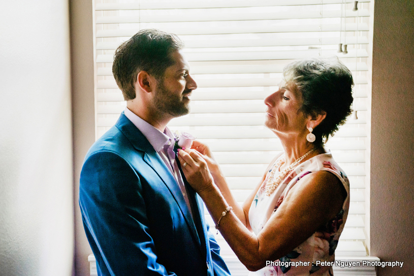 Indian Mother getting TIE done of indian Groom