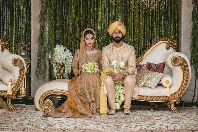 Groom wear either Kurta Pyjama, Sherwani, or formals like a suit, tuxedo, etc., whereas, for brides, it is Salwar Kameez or Sharara