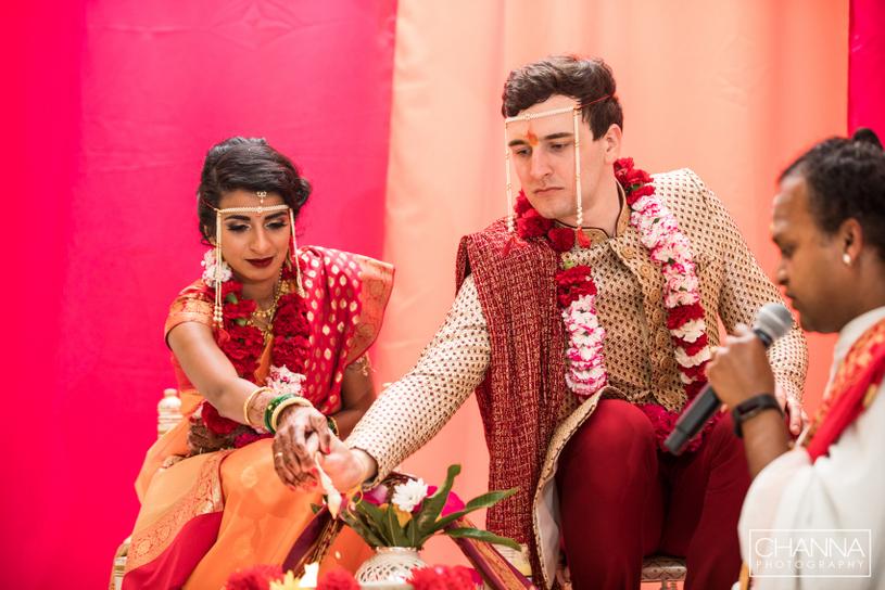 Wedding couple putting Ghee in Havan Kund