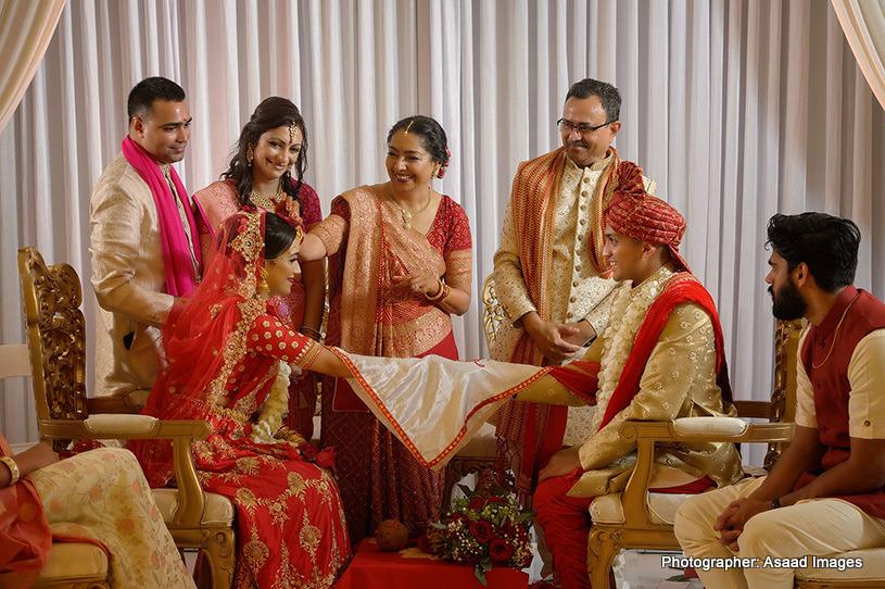 Mom applying Sindoor to Indian Bride