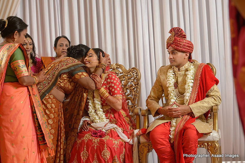 Indian Bride giving hug to mother