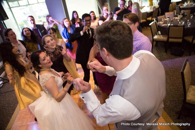 Wedding Couple dancing with wedding guest