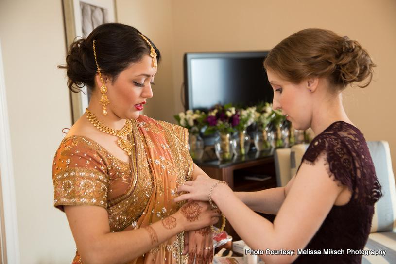 Indian bride wearing wedding chuda (wedding bengles)