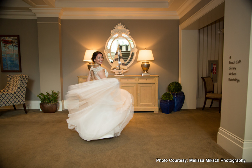 Bride standing wearing white sleeveless gown