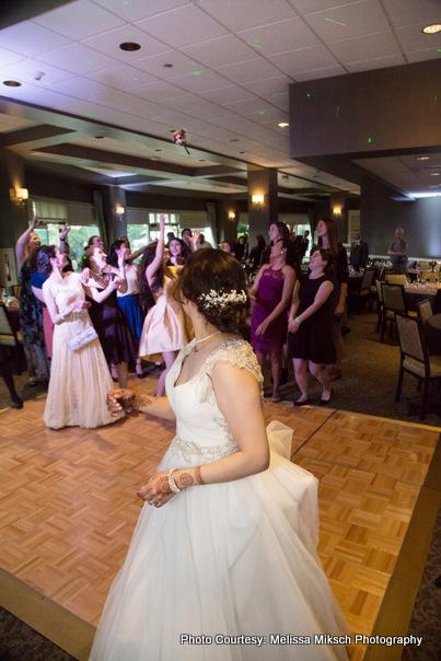 Bridesmaids going to catch Indian Brides bouquet