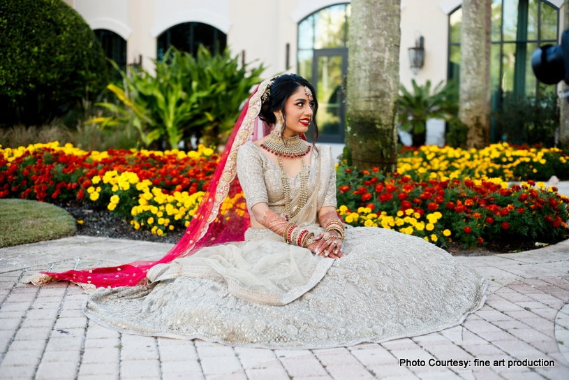Lovely Indian bride Posing Outdoor for photoshoot
