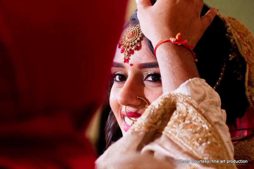 Applying Sindoor to Indian Bride