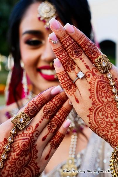 Bride posing her henna hand