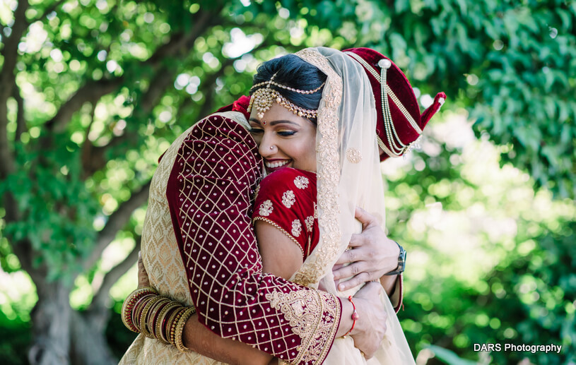 Tight hug by Indian Groom
