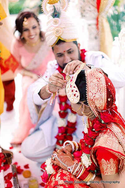 Indian Groom applying Sindoor on Bride's Forehead