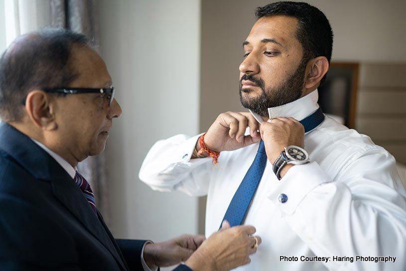 Father helping Indian Groom to get ready