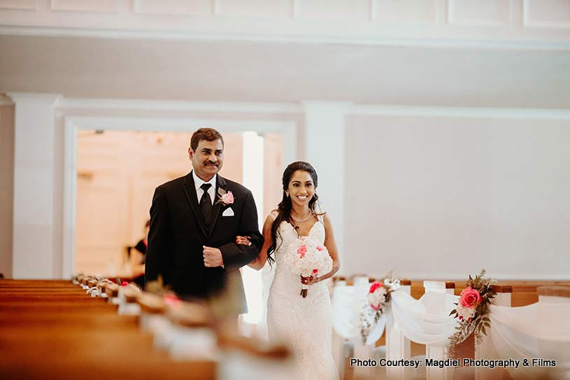 Bride entering wedding venue with her father
