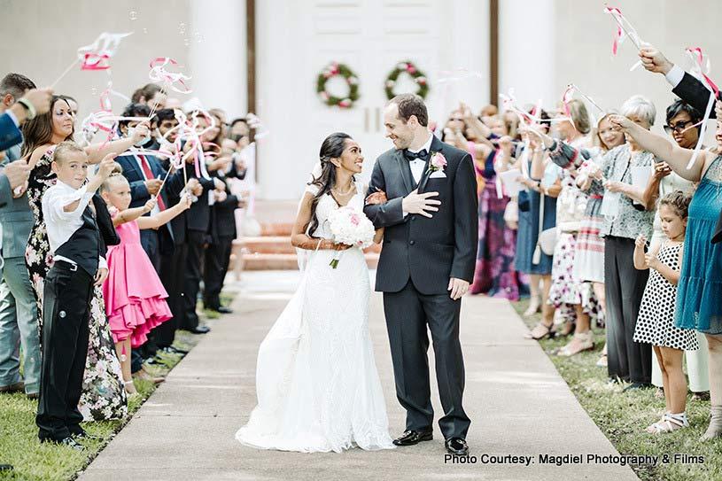 Couple walking to the wedding spot