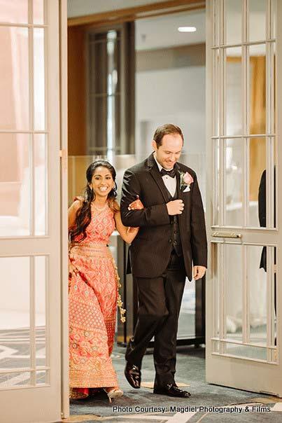 Bride entering at the venue with groom