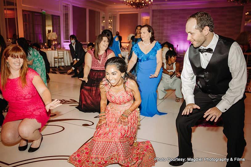 Couple having fun at wedding party