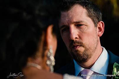 Groom looking in bride's Eyes